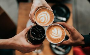 Hand of friends holding coffee