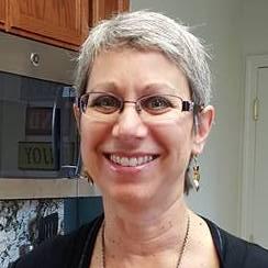Headshot of Susan Madden smiling.
